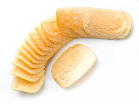 Potato chips isolated white background. Фото со стока