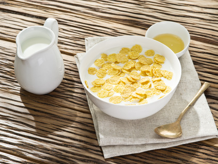 corn meal: Cornflakes cereal and milk. Morning breakfast.