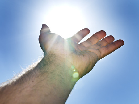 man's: Sun in the mans hand. Stock Photo