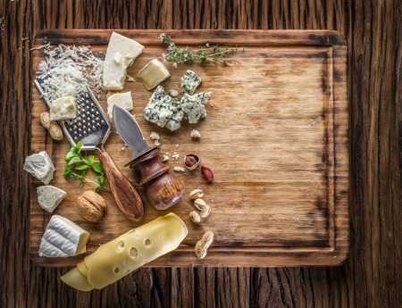 delicatessen: Different types of cheeses with nuts and herbs. Top view.