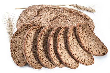 pastry crust: A loaf of bread and slices on a white background.