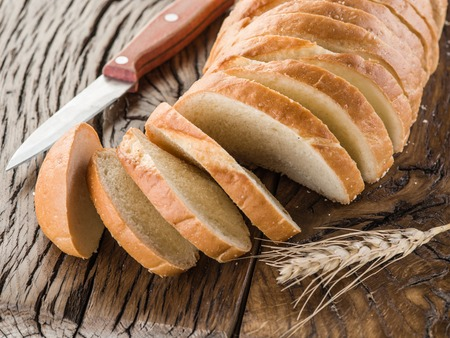 white bread: Sliced white bread on the old wooden plank. Stock Photo