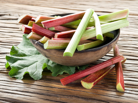 rhubarb: Rhubarb stalks on the wooden table. Stock Photo
