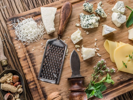 different types of cheese: Different types of cheeses with nuts and herbs. Top view.