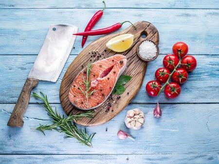 fresh fish: Fresh salmon on the cutting board. Cooking process.