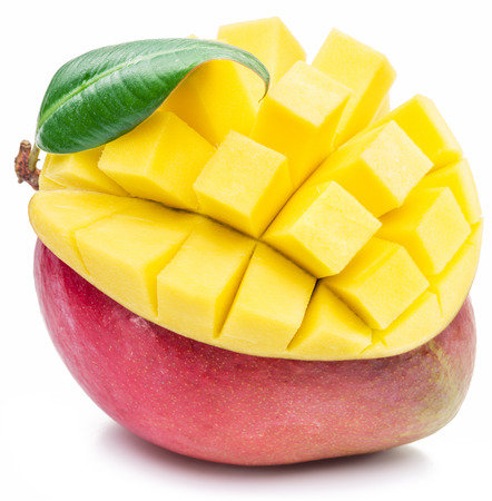 sliced: Mango fruit and mango cubes on the white background. The picture of high quality. Stock Photo