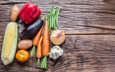 fresh food: Fresh organic vegetables on the wooden table. Top view.