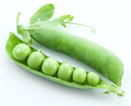 pea pod: Open pea pod on a white background.