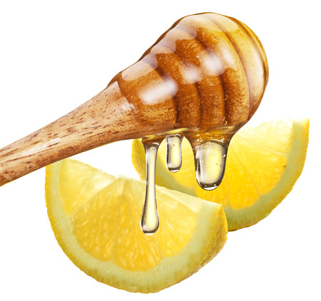 wood stick: Honey with wood stick pouring onto a slice of lemon. White background. Clipping path.