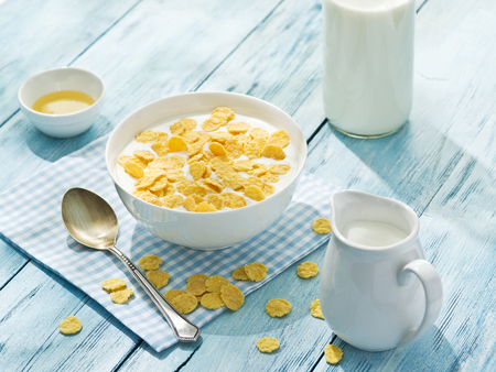 oat: Cornflakes cereal and milk. Morning breakfast.