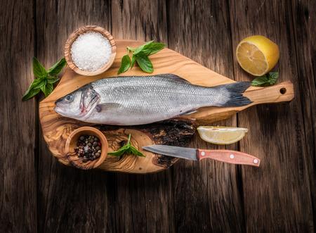 sea bass: Seabass fish on the graphite board. Stock Photo