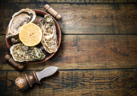 seafood: Raw oysters on the old wooden table.