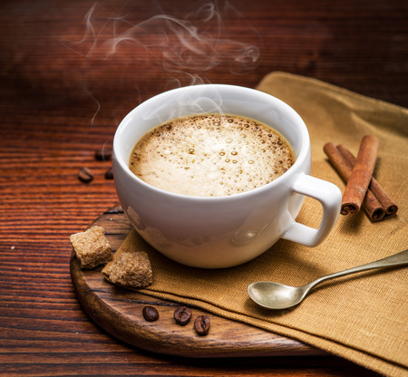 cappuccino cup: Cup of cappuccino on the aged wooden tray.
