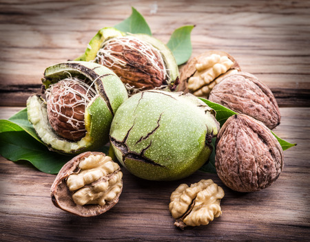 kernel: Walnut and walnut kernel on the wooden table. Stock Photo