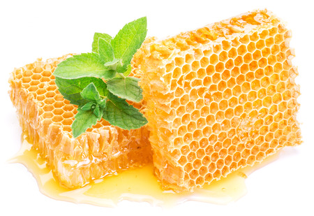 Honey comb: Honeycomb and mint on a white background.  High-quality picture. Stock Photo