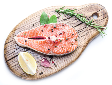 white board: Salmon steak wooden cutting board. Stock Photo