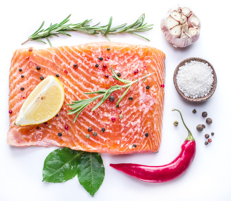 salmons: Salted salmon fillet on the white background.