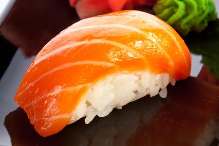 sushi: Traditional japanese food. Raw salmon sushi.