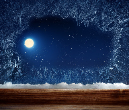 windowpanes: Winter window with frosted inside. Outside stars and the moon.