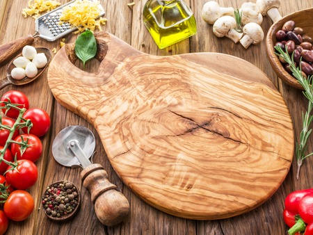 pizza ingredients: Pizza ingredients: mushrooms, olives, cheese and tomatoes. Stock Photo