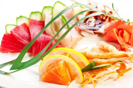 garnish: Traditional japanese food. Raw seafood with garnish.