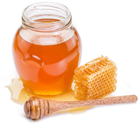 honey jar: Jar full of fresh honey and honeycombs. High-quality picture.