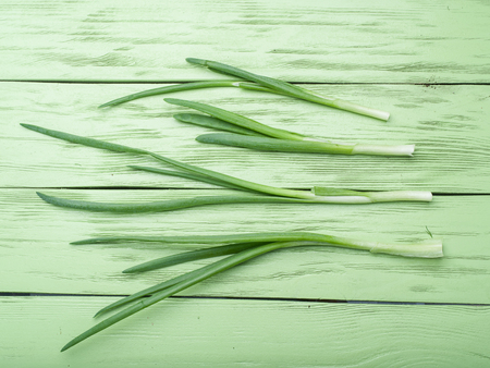 spring onions: Green onion on the wooden background. Stock Photo