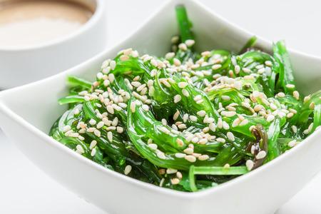 edible: Wakame salad with sesame. Traditional japanese food.