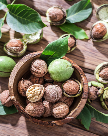 walnut: Walnuts in the wooden bowl on the table. Stock Photo