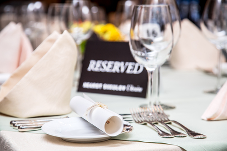formal dinner party: Festival dinner setting and Reserved sign.
