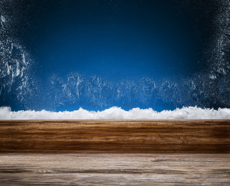 wooden window: Winter window with frost patterns in the night. Focus on the windowsill. Stock Photo
