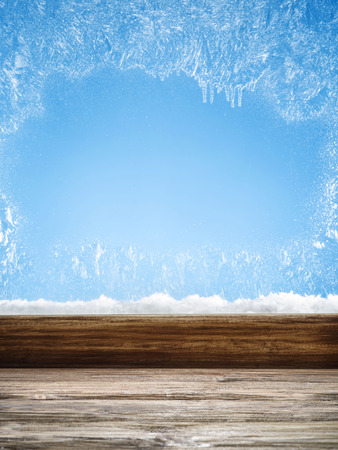 windowpanes: Winter window with frost patterns in the day. Focus on the windowsill. Stock Photo