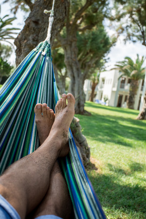 escapism: Relaxing in the hammock. Summer day.