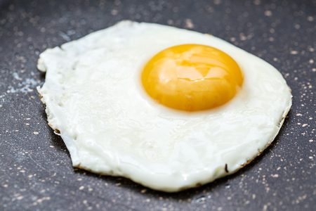 sunny side up: Fried egg in the frying pan.