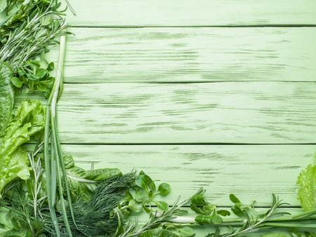 green herbs: Green herbs on the green wooden background.