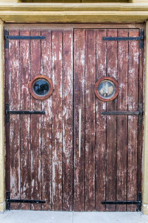 old wooden door: Old wooden door with big spy hole.