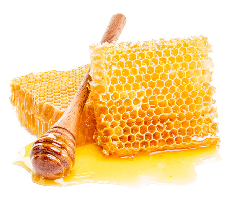 drizzler: Honeycomb and honey drizzler on a white background.