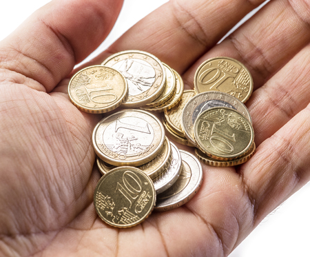 old hand: Euro coins on the mans palm on white background.