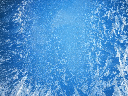 deep freeze: Frosty patterns on the edge of a frozen window.