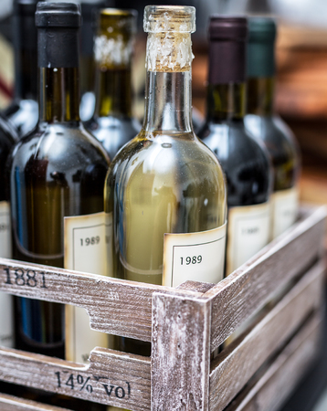 white wine: Old wine bottles in a wooden crate. Editorial