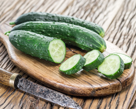 cucumbers: Cucumbers on the wooden table.
