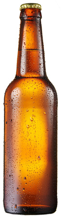 brown bottle: Cold bottle of beer with condensated water drops on it.