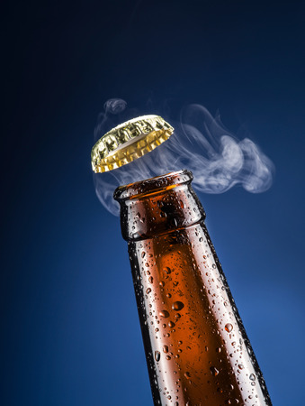 unbottled: Opening of beer cap with the gas output.