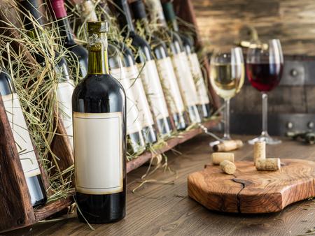 the shelf: Wine bottles on the wooden shelf. Stock Photo