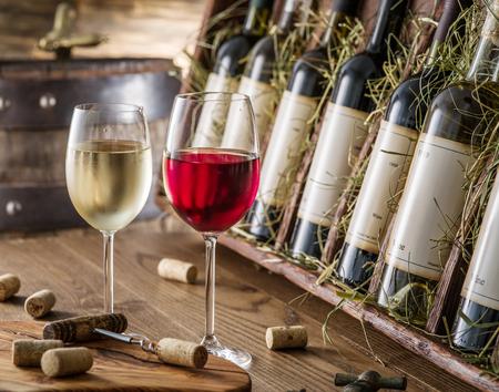 the shelf: Wine bottles on the wooden shelf. Editorial