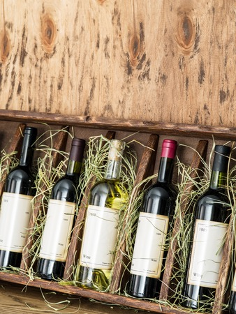 wine testing: Wine bottles on the wooden shelf. Editorial