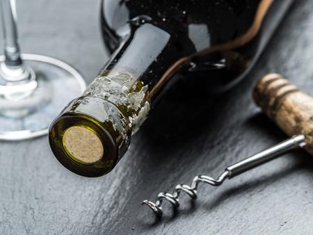 grafit: Wine bottle, wine glass and corkscrew on the graphite board.