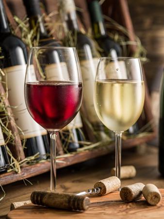 Wine bottles on the wooden shelf. Stockfoto