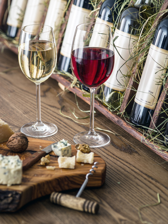 wine testing: Glasses of wine and cheese plate. Wine testing. Editorial