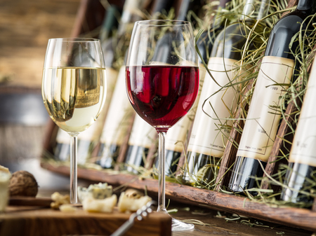 wine glasses: Glasses of wine and cheese plate. Wine testing. Stock Photo